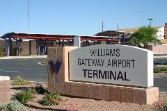 Williams Gateway Airport Terminal sign next to a road.