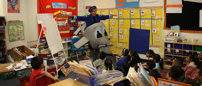 Amelia the mascot speaks to a school-cropped