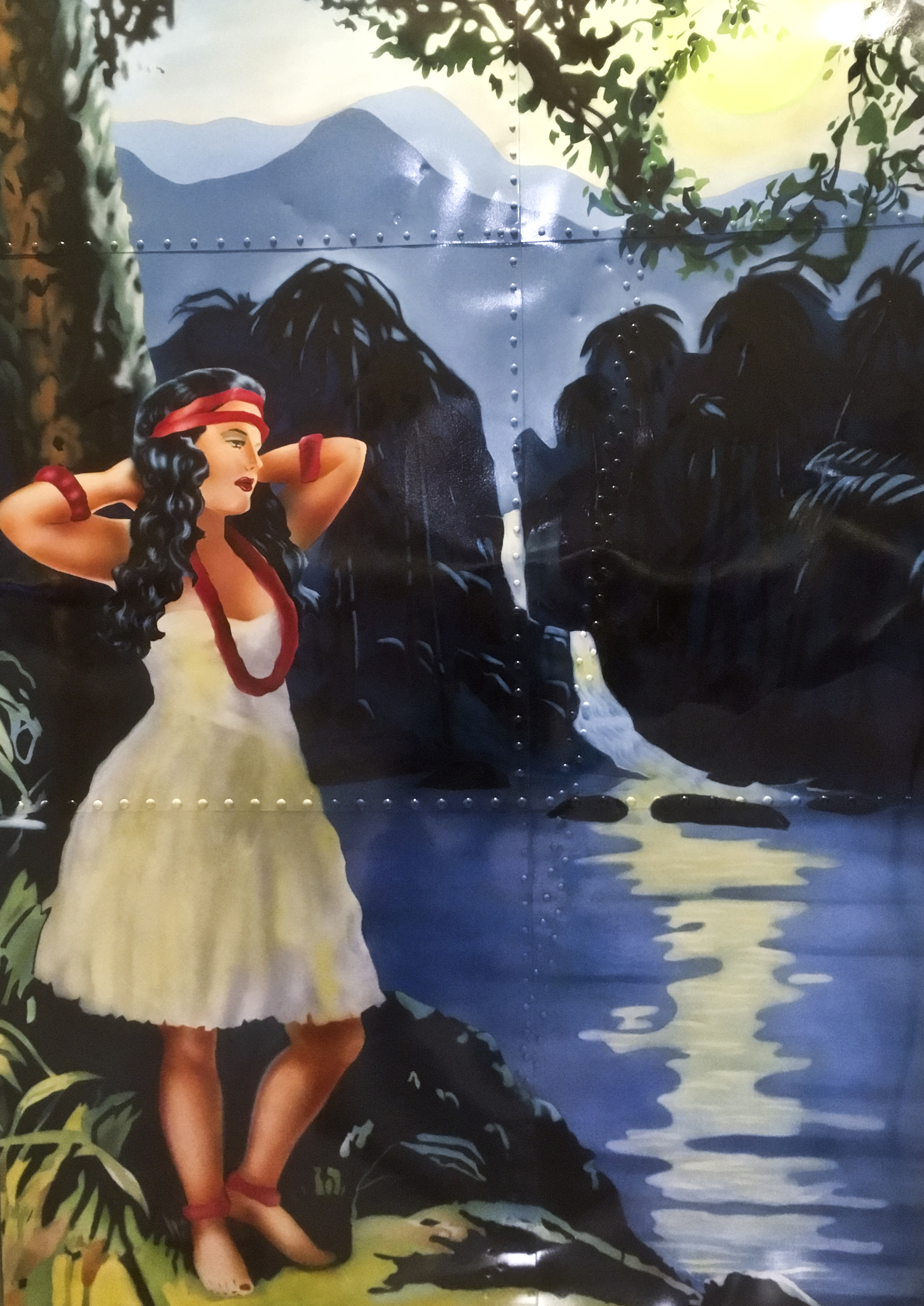 airbrushed image of woman in a tropical location