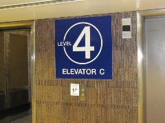 Zone C sign within parking garage elevator core