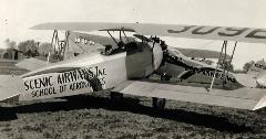 Scenic Airways Bi-plane with two women