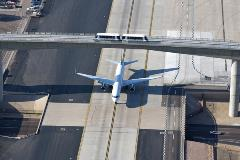 PHX Sky Train with plane on taxiway