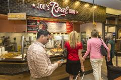 Joe's offers real food – barbecue slow-cooked over pecan wood and equally delicious side dishes and desserts. From a variety of meal plates to sandwiches to specialties such as stuffed baked potatoes, you'll find real tasty and memorable dishes at Joe's.