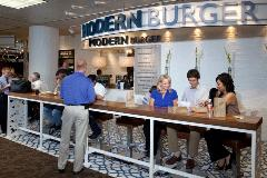 At Modern Burger, small, square-shaped sliders are the mainstay of the menu. The juicy Angus beef sliders or turkey patties are served on brioche buns with a variety of toppings.